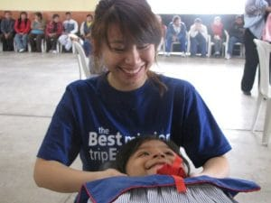 Dr Jenny treating a young Peruvian girl's neck