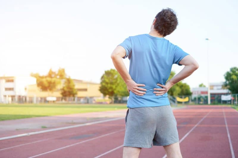 man suffering from slipped disc pain