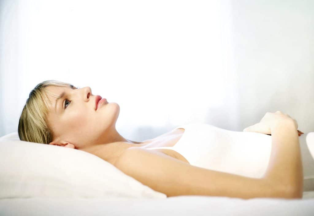 woman lying on the bed thinking