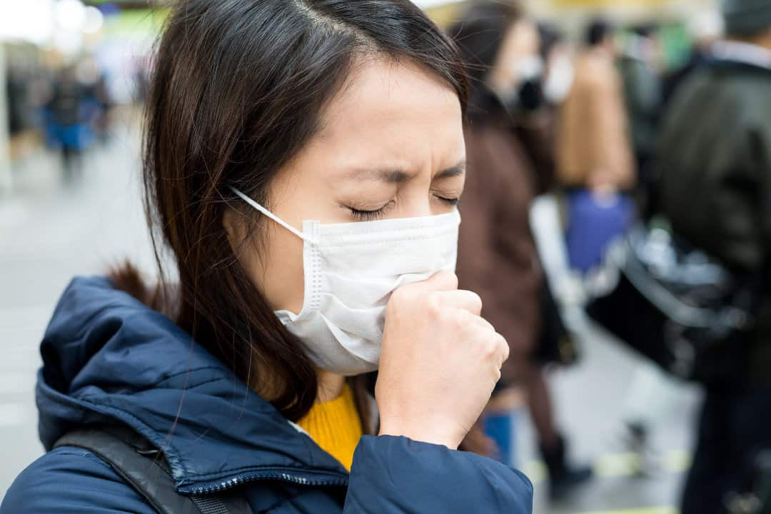 Woman suffer from sick in crowded of people